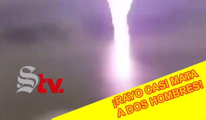 Rayo casi mata a dos hombres, al caer a pocos metros