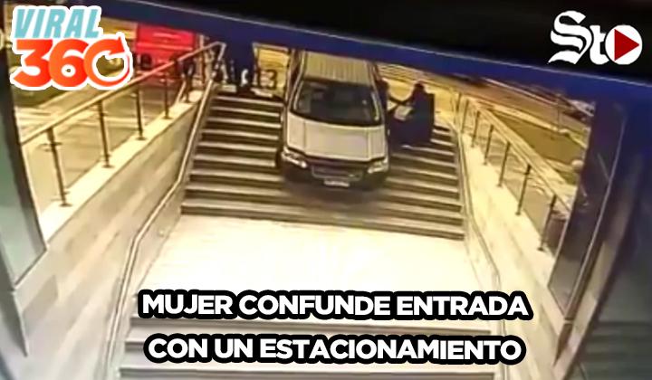 Una conductora se estaciona en una entrada