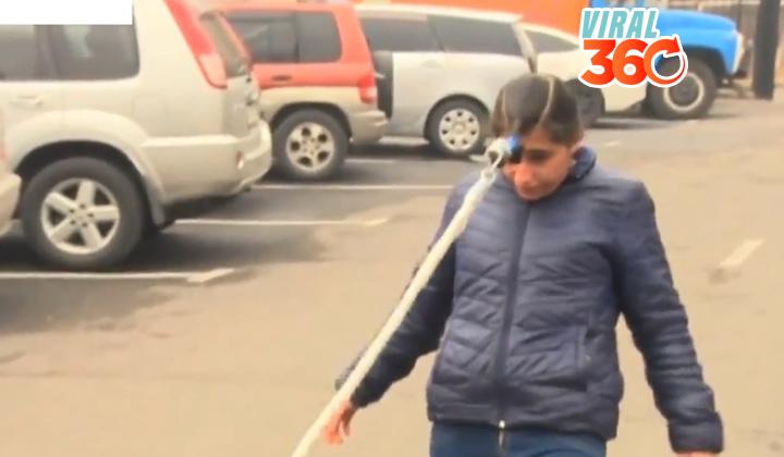 Joven armenia arrastra con su cabello un auto de 2 toneladas