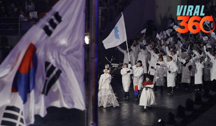 Coreas desfilan bajo una misma bandera