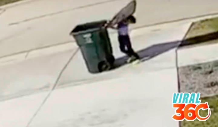 Niño intentaba sacar la basura y el aire le juega cómica jugada