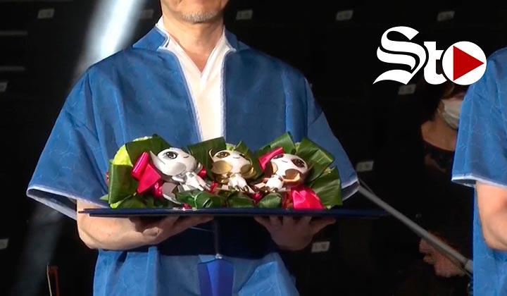 Flores de Fukushima en manos de campeones olímpicos